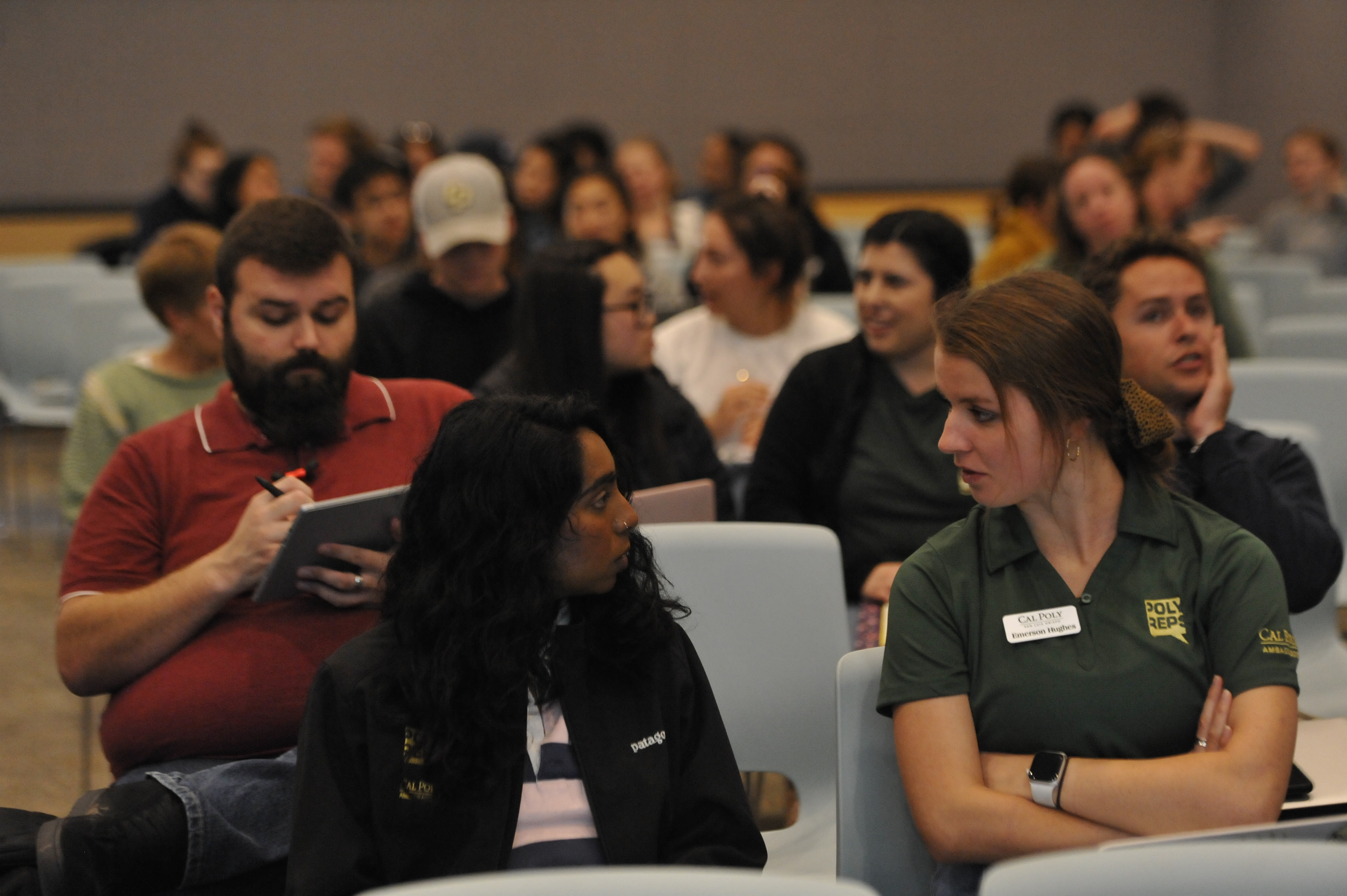 "Two students discuss during a call called ""Cal Poly Privilege: Investigating our Campus Demographics"" at the fourth annual Teach In event at cal poly."