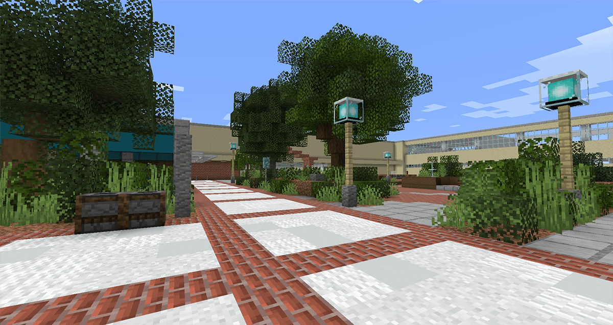 A view of a brick-lined and tree-filled courtyard built in Minecraft