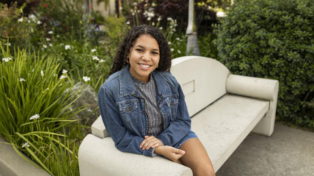 Cal Poly student Miaya May sitting on bench