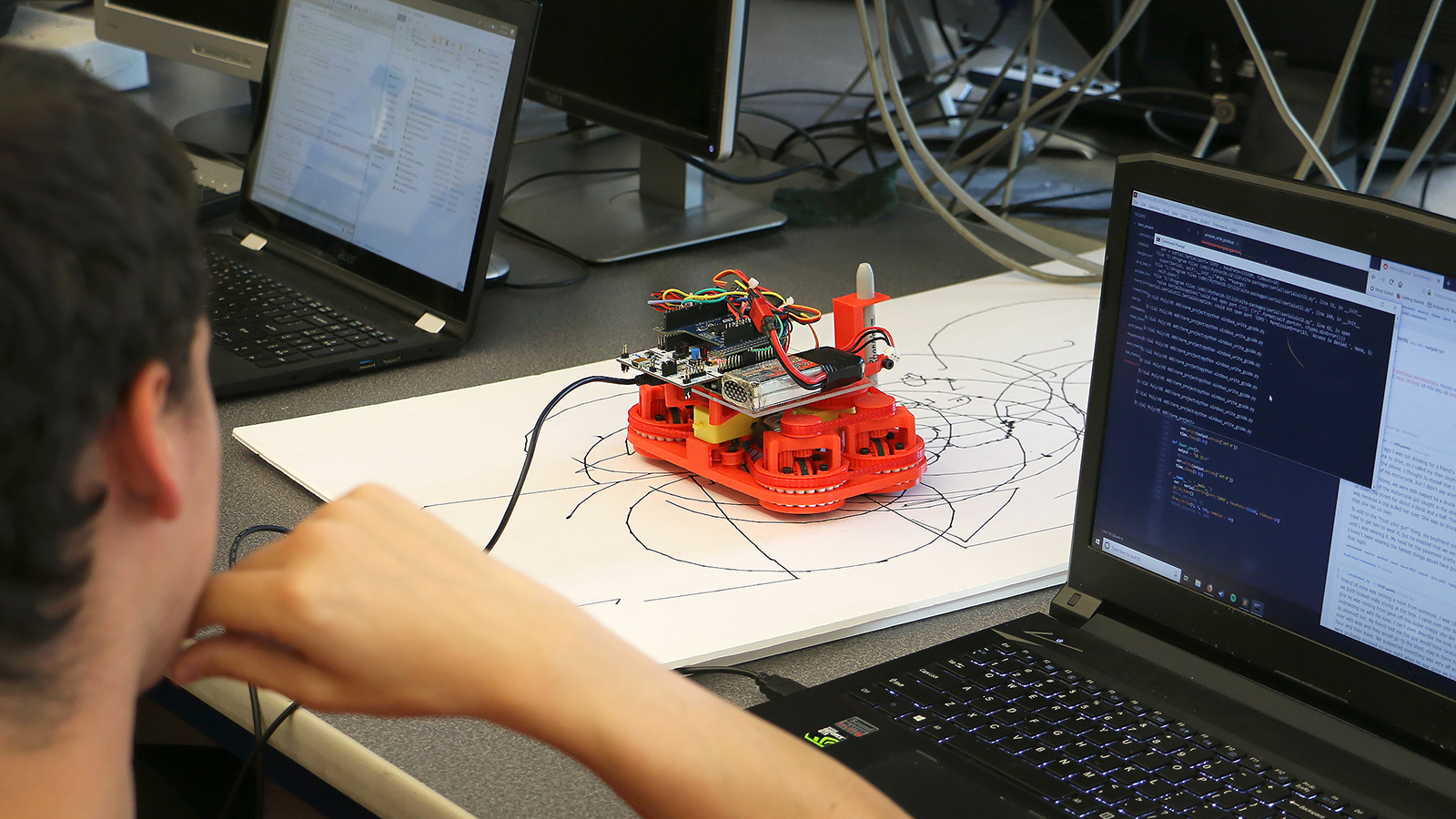Mechanical Engineering students work with autonomous robots in the Mechatronics Lab.